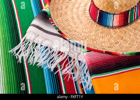 Traditional Mexican serape blankets or rugs with sombrero. - Stock Photo