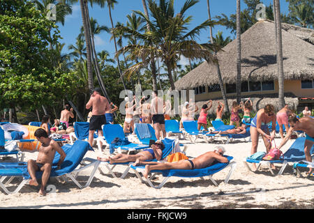 mass tourism at the beach of Playa Bavaro, Punta Cana,  Dominican Republic, Carribean, America, - Stock Photo