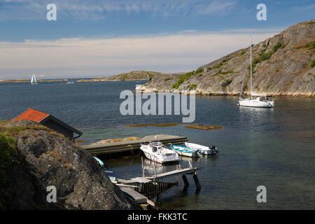 Yacht at anchor in sheltered inlet, Hälleviksstrand, Orust, Bohuslän Coast, Southwest Sweden, Sweden, Scandinavia, - Stock Photo