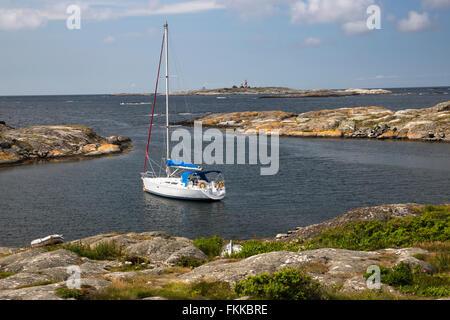 Yacht anchored in sheltered inlet, Käringön island, Bohuslän Coast, Southwest Sweden, Sweden, Scandinavia, Europe - Stock Photo