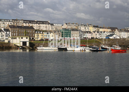 Houses overlooking the harbour in Portrush, County Antrim, Northern Ireland. - Stock Photo