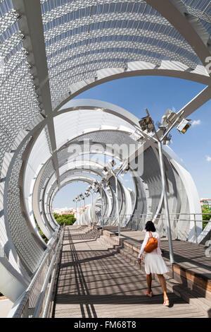 A view of a modern new bridge structure in Madrid called The Pasarela del Arganzuela pedestrian bridge. - Stock Photo