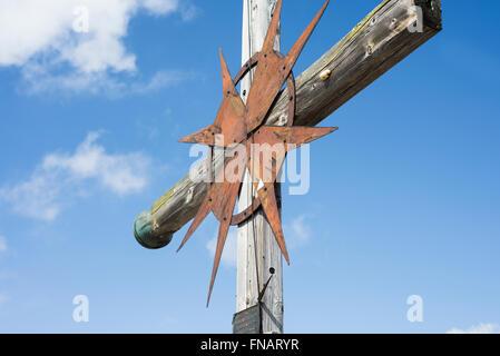 Latin summit cross in the European Alps against the blue sky, Mount Guffert, Rofan, Tirol, Austria - Stock Photo