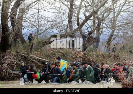 Chamilo, Greece. 14th March, 2016. Refugees try to cross a stream near the Greek village of Chamilo on March 14, - Stock Photo