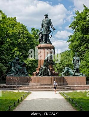 Senior man looking at Bronze Bismarck memorial In the Tiergarten Public park in Summer, Berlin - Stock Photo