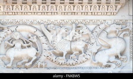 Bass relief on the Portal of San Michele in Foro Church in Lucca, Italy, on June 06, 2015 - Stock Photo