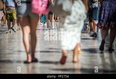 Tourists at Stradun (Placa) - limestone-paved pedestrian street in Old Town of Dubrovnik, Croatia. View with Bell - Stock Photo