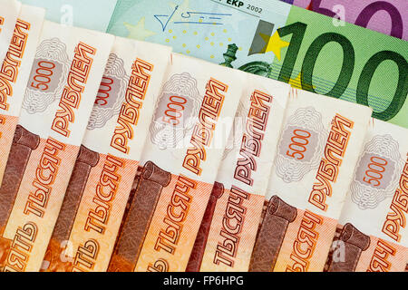 100, 500 euro and 5000 russian roubles banknotes - Stock Photo