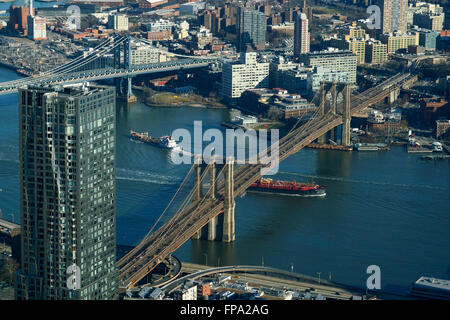 Aerial view of Lower Manhattan with Manhattan Bridge and Brooklyn Bridge over East River and borough of Brooklyn - Stock Photo