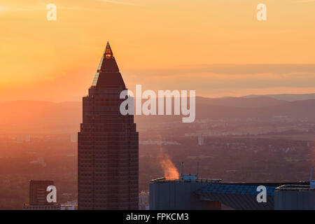Europe, Germany, Hessen, Frankfurt, Messeturm at sunset - Stock Photo