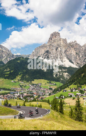 Motorcyclist, Corvara,in the background the Sassongher, the Dolomites, South Tyrol, Italy, Europe, - Stock Photo