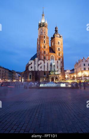 Poland, city of Krakow (Cracow) at night, St Mary Basilica (Mariacki Church, Bazylika Mariacka) on Main Market Square - Stock Photo