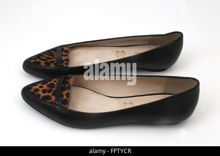 Pair Of Leather Flat Shoes With Faux Fur Print - Stock Photo