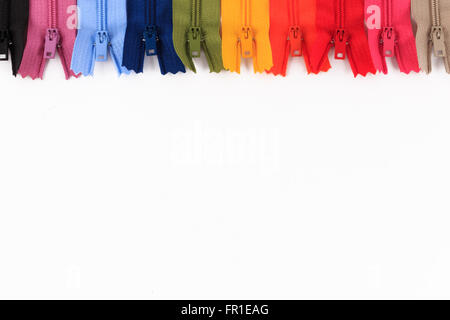Colorful zippers in different colors on white background. - Stock Photo