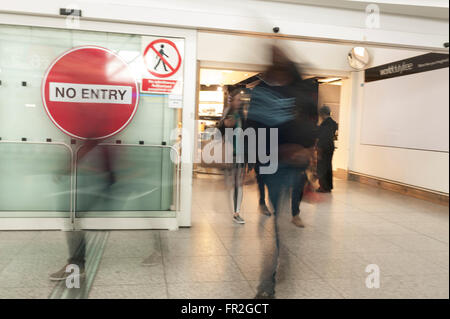 Airport arrivals departures international flights matter of waiting for cancellations and arrivals - Stock Photo