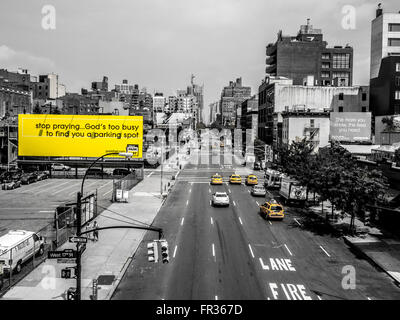 Billboard sign on 10th Avenue, New York City, USA: Stop praying... God's too busy to find you a parking spot - Stock Photo