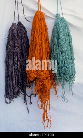 Tunisia, Brightly dyed wool hung up to dry - Stock Photo