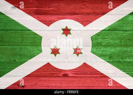 Burundi Flag painted on old wood plank background - Stock Photo