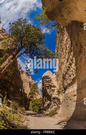 Hiking along the Slot Canyon Trail at Kasha-Katuwe Tent Rocks National Monument in New Mexico, USA - Stock Photo