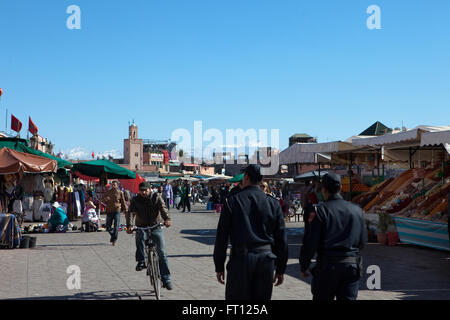 Djemaa el Fna during the day with the High Atlas mountains in the background, Marrakech, Morocco - Stock Photo