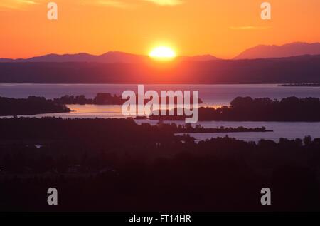 Lake Chiemsee with Fraueninsel in sunrise, Bavaria, Germany - Stock Photo