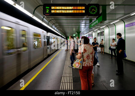 People waiting for the U2 line train at Schottenring U-Bahn subway metro station in Vienna, Austria, Europe - Stock Photo