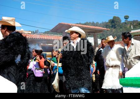 Sunday religious procession in San Juan Chamula near San Cristobal de las Casas, Chiapas, Mexico - Stock Photo