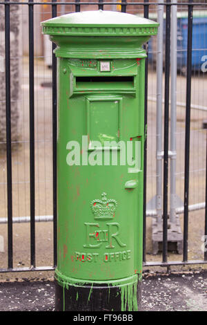 West Belfast, Ireland. 25th March, 2016.  A Royal mail Pillar box which is usually red has been painted green in - Stock Photo