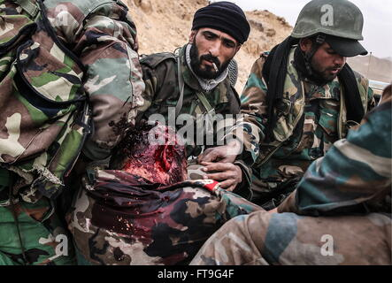 Palmyra, Syria. 26th Mar, 2016. An injured soldier of the Syrian government army at the Fahkr ad-Din al-Maani castle - Stock Photo
