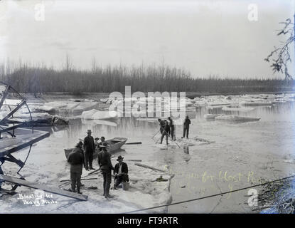 Antique c1910 photograph, Blasting Ice in Peavey, Alaska. Also noted, 'Charging for blast, by T.J. Langston, Johnston, - Stock Photo