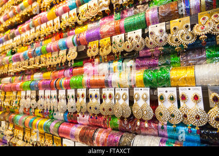 Indian bangles and colorful earrings on display - Stock Photo