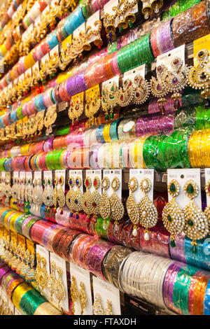 Indian bangles and colorful earrings on retail display - Stock Photo