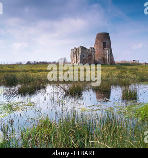 St Benets Abbey. Site of 11th century abbey ruins and 18th century wind pump beside the River Bure in the Norfolk - Stock Photo