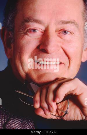 Studio portrait of distinquished balding gentleman - Stock Photo