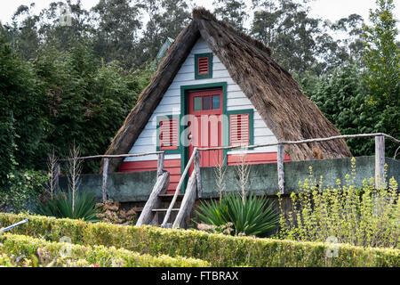 Typical old houses on Santana, Madeira island, Portugal - Stock Photo
