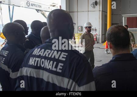 ATLANTIC OCEAN (Jan. 24, 2015) Military Sealift Command civil service mariner Chief Mate James Regan addresses a - Stock Photo
