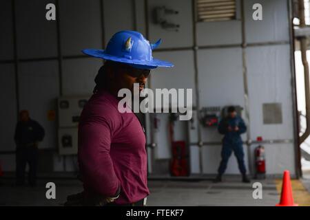 ATLANTIC OCEAN (Jan. 24, 2015) Military Sealift Command civilian mariner Joe Lyons stands by to conduct Military - Stock Photo