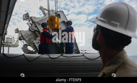 ATLANTIC OCEAN (Jan. 24, 2015) Chief Mate James Regan, right acts as a safety observer as Boatswain's Mate 1st Class - Stock Photo