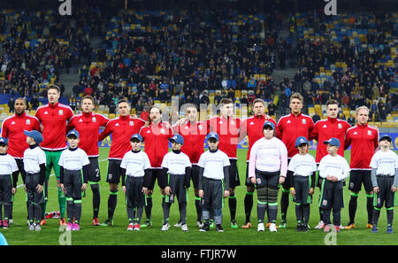 Kyiv, Ukraine. 28th March, 2016. Players of National football team of Wales sing National anthem before Friendly - Stock Photo