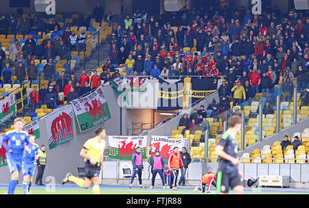 Kyiv, Ukraine. 28th March, 2016. Welsh supporters support their team during Friendly match between Ukraine and Wales - Stock Photo