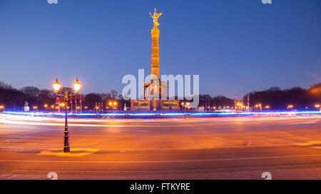 The Berlin Siegessaeule (Victory Column) in Tiergarten park, seen at twilight - Stock Photo