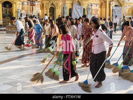 Burmese women sweep the floor of Shwedagon Pagoda, Yangon (Rangoon), Myanmar (Burma) - Stock Photo