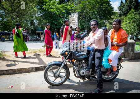 Indian family of 4 all sat astride a Bajaj motorcycle at the side of a street in Tindivanam, Viluppuram, Tamil Nadu, - Stock Photo