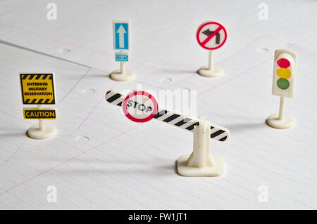 Notepad, book of traffic rules, toy cars, traffic lights and stop sign on a desk table. Studying and preparing for - Stock Photo