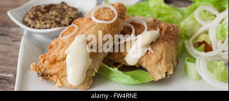 deep fried breaded chicken with salad and french fries - Stock Photo