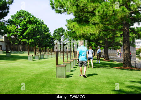 Vistors walk the grounds of the Field of Chairs honoring victims of the Oklahoma City bombing. USA. - Stock Photo