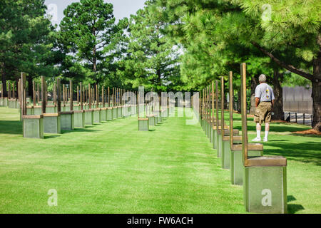 Vistors walk the grounds of the Field of Chairs honoring victims of the Oklahoma City bombing. Oklahoma City, Oklahoma, - Stock Photo