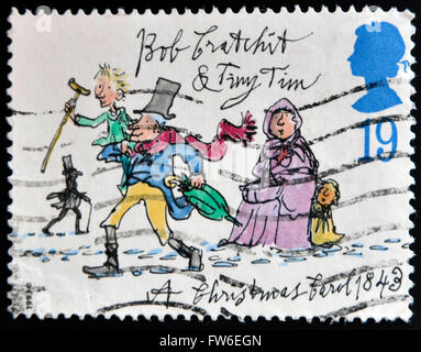 UNITED KINGDOM - CIRCA 1993: A stamp printed in Great Britain dedicated to Christmas shows Bob Cratchit and Tiny - Stock Photo