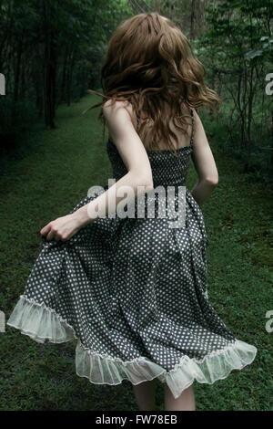 Woman running away - Stock Photo