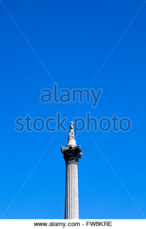 Nelsons column set against a deep blue sky in the capital of the UK, London. Standing in Trafalguar square the memorial - Stock Photo